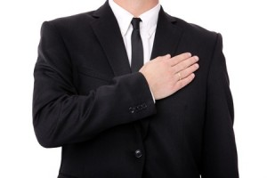 Businessman with hand over heart