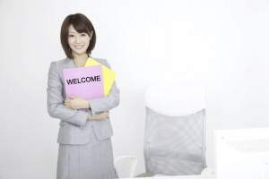 Business woman holding Welcome documents