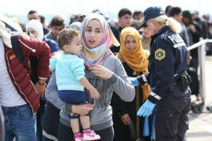 Migrants - young Syrian woman with child