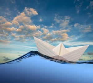 Paper-boat-drifting-on-rolling-sea