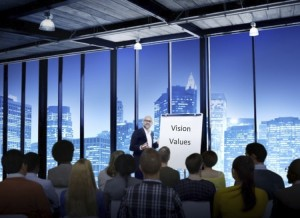 business-leader-presenting-vision-values-to-a-crowd