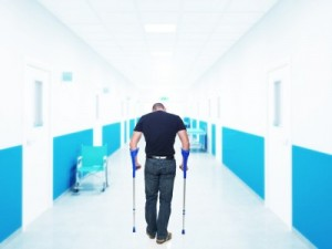 Man-on-crutches-in-hospital-300x225